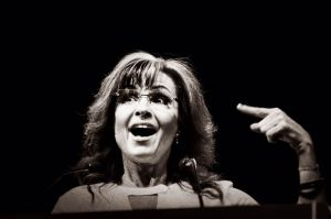Sarah Palin pointing to the emptiest vessel in the arena.