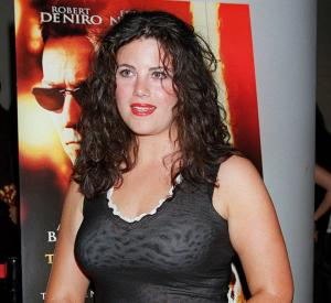 Monica Lewinsky poses for photographers as she talks about her affair with President Clinton.